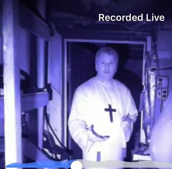 Lead Investigator Robert Murphy using a robe and cross as a trigger at a negative location during a live paranormal investigation